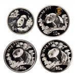 """1997年熊猫加字系列纪念银币四枚套装,其中包括:面值5元,重量1/2盎司的""""97年香港国际钱币博览会""""熊猫加字币一枚;面值10元、重量1盎司的""""97国际旅游年""""、""""重庆直辖市成立纪念""""熊猫加字币各一"""