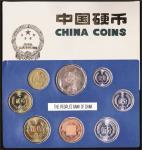 1981年中国人民银行发行普制硬币全套七枚套,带外包装盒,附有鸡年纪念章一枚,包装微黄,近未使用品